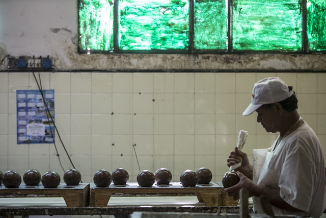 A worker decorates chocolate Easter eggs preparing for Holy Week at the company of Chocolate Arrufat in Buenos Aires, capital of Argentina, on Apr. 1, 2015. Arrufat is one of the 150 recovered factories that are led by their employees, currently has 28 employees and plan production for easter of about seven thousand kilograms of chocolate. (Xinhua/Martin Zabala)