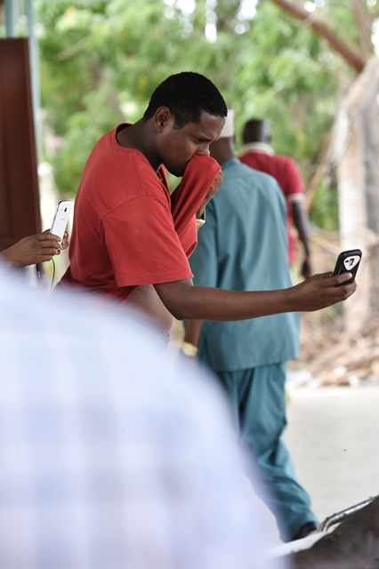 A man takes pictures of the body of a campus attack terrorist which is to be analyzed in Garissa county hospital, Garissa, Kenya, April 4, 2015. Kenya's Interior Minister Joseph Nkaissery said on Friday the death toll of the attack at the Garissa University College includes 142 students, three policemen and three soldiers from Kenya Defense Forces. The four terrorists from 'al-Shabaab' were all killed during the rescue operation, the official confirmed. (Xinhua/Sun Ruibo)(dh)