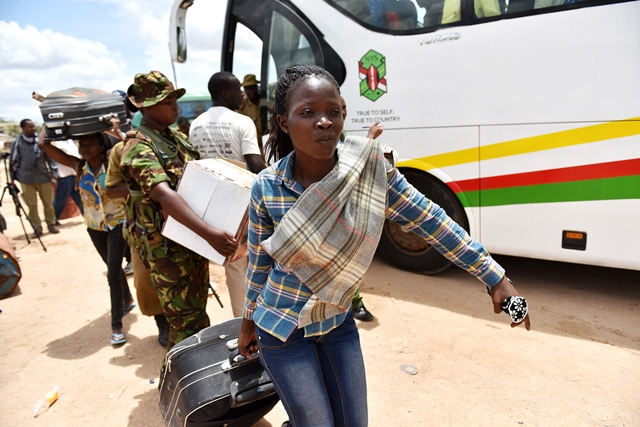 Survivor students prepare to leave for home in Garissa, Kenya, April 4, 2015. A total of 663 survivors from a Kenyan university attack left Garissa town for their homes Saturday. The survivors, including 50 school staff, were aboard 13 bus. They were departing after camping for two days. (Xinhua/Sun Ruibo)