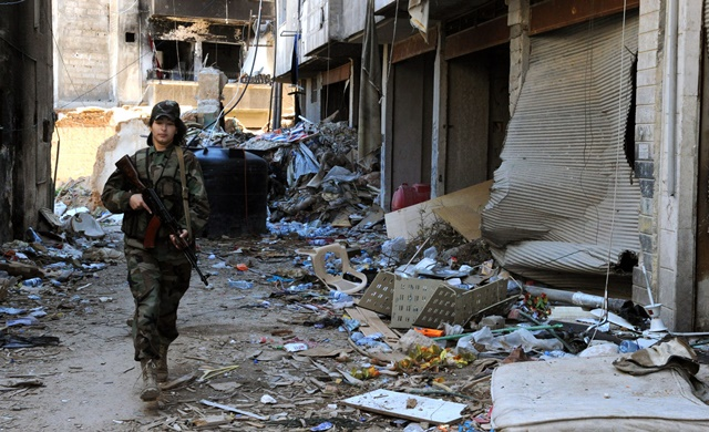 A female sniper patrols in Daraya suburb of the capital Damascus, Syria, on April 5, 2015. The snipers are members of the female force in Syrian Republican Guards. Their unit consists of around 800 volunteer, unmarried, female fighters- aged between 20 and 24 years old. Their task is to work alongside the Syrian army in its battle against the rebels. (Xinhua/Zhang Naijie) (jl)