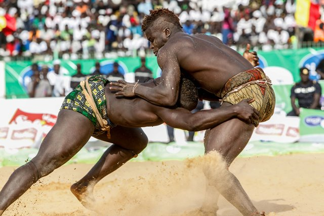 Wrestlers compete in the Senegalese traditional wrestling match