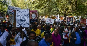 People holding anti-xenophobia placards take part in the People's March Against Xenophobia in Johannesburg Town, South Africa, on Apr. 23, 2015. Thousands of South Africans and foreigners took part in the peace march in Johannesburg on Thursday, calling for an end to xenophobia violence. (Xinhua/Zhai Jianlan)