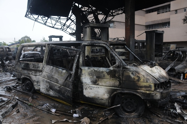 Photo taken on June 4, 2015 shows the wreck of a vehicle after a fuel station explosion in Accra, capital of Ghana. Over 96 people were killed in a fuel station explosion in Accra, official of the fire service confirmed. Prince Billy Anaglatey, the Deputy Public Relations Officer of the Ghana National Fire Service (GNFS) said the agency retrieved the bodies from the debris of the Goil filling station located at the circle on Wednesday night. A large number of the victims were seeking refuge at the fuel station after a heavy downpour when the explosion occurred. Many parts of Accra were completely submerged after several hours of torrential rains on Wednesday night leaving many roads impassable and residents homeless. (Xinhua/Lin Xiaowei)