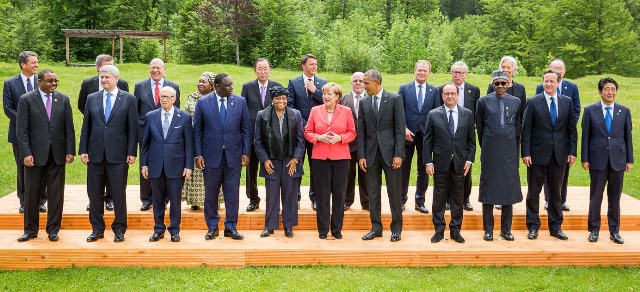 German Chancellor Angela Merkel (C), U.S. President Barack Obama (5th R), French President Francoise Hollande (4th R), British Prime Minister David Cameron (2nd R), Nigerian President Muhammadu Buhari (3rd R), President Ellen Johnson Sir-Leaf Of Liberia (5th L), President Macky Sall of Senegal (4th L), Ethiopian Prime Minister Haile Mariam Desalgn (1st L) and other delegates pose for a group photo during the working session of the G7 Outreach Programme in Schloss Elmau, Bavavia, Germany, June 8, 2015. (Xinhua/NAN)