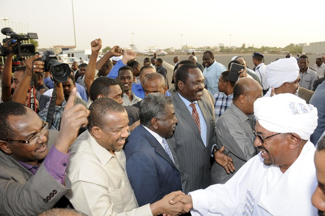 Sudanese President Omar al-Bashir (1st R, front) shakes hands with supporters after he returned to the Sudanese capital Khartoum on June 15, 2015. Omar al-Bashir on Monday returned to Khartoum from South Africa after he attended the 25th summit of the African Union (AU) there. (Xinhua/Mohamed Khidir)