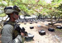 Image provided by the Defense Ministry of Colombia shows a soldier guarding after an operation in a jungle area in Acandi, Colombia, July 6, 2015. Colombian Defense Minister Luis Carlos Villegas informed that Colombia seized 3 tons of cocaine, allegedly with Mexico as the destination. (Xinhua) (zjy)