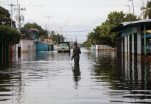 A person walks in a flooded street in the town of Guasdualito, Apure state, Venezuela, on July 7, 2015. According to local press, more than 9,000 families were affected by the floods caused by the overflowing of the rivers Arauca and Sarare. (Xinhua/Str) (jp)