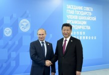 Chinese President Xi Jinping (R) is welcomed by his Russian counterpart Vladimir Putin during the 15th Shanghai Cooperation Organization (SCO) summit in Ufa, Russia, July 10, 2015. (Xinhua/Zhang Duo) (zkr)