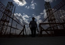 Photo taken on July 14, 2015 shows a staff member walking inside the construction site of the Rostov Arena in Rostov-on-don, Russia. Russia will host the FIFA World Cup soccer tournament in 2018. (Xinhua/Li Ming)