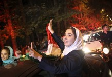 """Iranians celebrate the nuclear agreement in Tehran, Iran, on July 14, 2015. The deal ushered in a new era for Iran's relations with the world. """"If the deal is implemented, the wall of distrust between Iran and western powers will be gradually demolished,"""" Iranian President Hassan Rouhani said. (Xinhua/Ahmad Halabisaz)"""