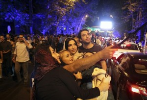 """Iranians celebrate the nuclear agreement in Tehran, Iran on, July 14, 2015. The deal ushered in a new era for Iran's relations with the world. """"If the deal is implemented, the wall of distrust between Iran and western powers will be gradually demolished,"""" Iranian President Hassan Rouhani said. (Xinhua/Ahmad Halabisaz)"""