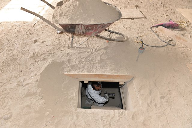 A specialist inspects the tunnel where Mexico's drug kingpin Joaquin