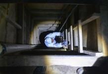 "A specialist inspects the tunnel where Mexico's drug kingpin Joaquin ""El Chapo"" Guzman escaped through, in Almoloya de Juarez, Mexico, on July 14, 2015. Mexican drug lord Joaquin ""El Chapo"" Guzman could not have escaped from prison without inside help, Interior Minister Miguel Angel Osorio Chong said on Monday, pledging to bring to justice all those involved in the brazen scheme. (Xinhua/Mario V?zquez/MVT) (jp)"
