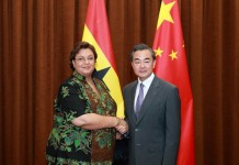 Chinese Foreign Minister Wang Yi (R) shakes hands with Ghanaian minister of Foreign Affairs and Regional Integration Hannah Tetteh in Beijing, China, July 16, 2015. (Xinhua/Ding Haitao) (zhs)