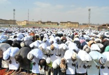Muslim faithfuls take part in the Eid al-Fitr prayers at Nakivubo stadium in Kampala, capital of Uganda, July 17, 2015. Muslim faithful in Uganda on Friday attended the Eid al-Fitr prayers which marks the end of Ramadan. Sheikh Ramadhan Mubajje, the Mufti of Uganda who led the prayers asked Muslims to be vigilant with their lives and security, following the increasing killings of Sheikhs in Uganda. (Xinhua/Joseph Kiggundu)