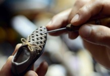 Peng Shizeng, a 55-year-old shoe designer, works on a mini shoe at a cultural and creative park in Jinan, capital of east China's Shandong Province, July 16, 2015. Peng started making the mini shoes since 2013, aiming at to attract more attention on this art. (Xinhua/Zhao Xiaoming)