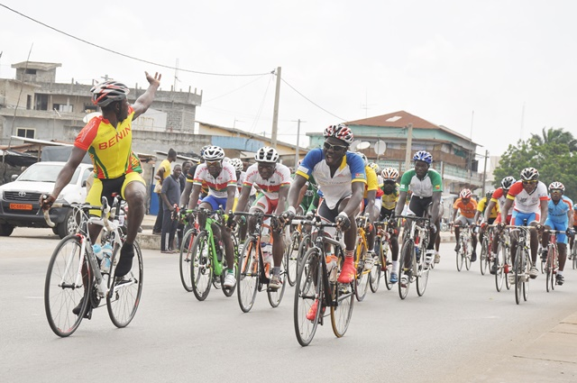 Cyclists compete during the 12th Benin International Cycling Tour in Cotonou, capital of Benin, July 19, 2015. At least 96 cyclists from Benin, Togo, Burkina Faso, Ghana, Cote d'Ivoire, France, Nigeria, Senegal and Congo took part in 12th Benin International Cycling Tour. The team of Burkina Faso won the trophy for the best Castel team in the competition. (Xinhua/Polycarpe Toviho)