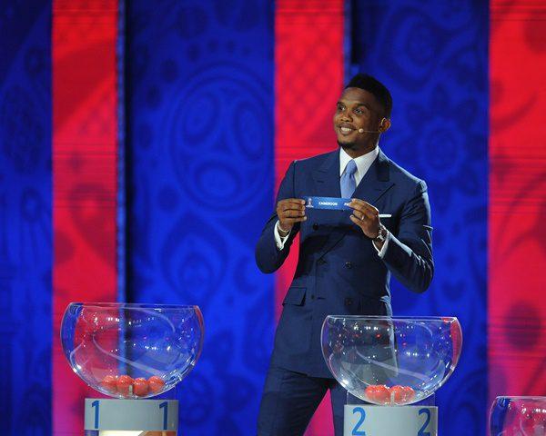 Cameroon's soccer player Samuel Eto'o holds up the slip showing