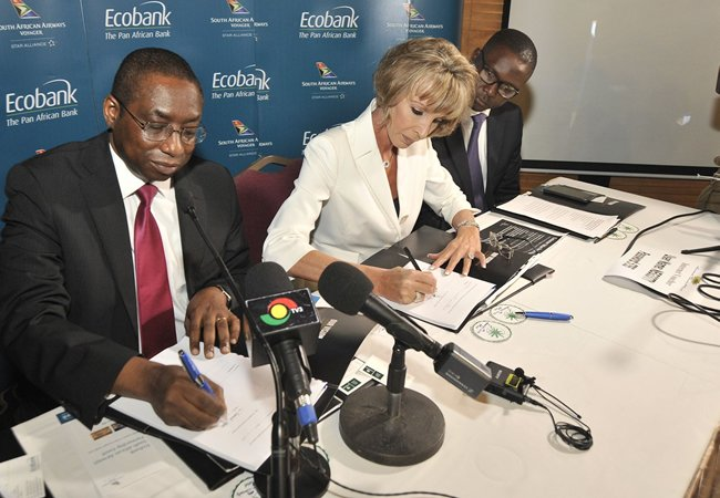 SAA Voyager CEO Suretha Cruse and Ecobank Managing Director for Ghana Mr Samuel Ashitey Adjei sign the agreement at the news conference