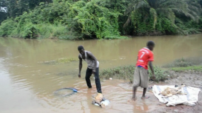 These boys are washing the intestines of the goats killed in the river for sale