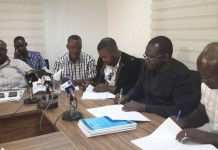 Picture from right to left, Mr Bernard Owusu, BOST Unionized Chairman, Mr Kwame Awuah-Darko BOST MD, Mr Francis Salas, Representative of TUC, some union Executives and Mr Kakra Essamuah, BOST Borad Chairman at the signing ceremony
