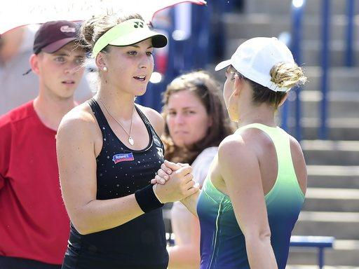 Belinda Bencic, of Switzerland, shakes hands with Simona Halep, of Romania, after the women's final at the Rogers Cup tennis tournament in Toronto, Sunday, Aug. 16, 2015. Halep retired in the third set due to injury. (Frank Gunn/The Canadian Press via AP)