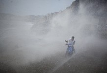 Huge waves brought by super typhoon Soudelor hit a rider on the coast in Wenling City, east China's Zhejiang Province, Aug. 8, 2015. (Xinhua/Zhou Xuejun)
