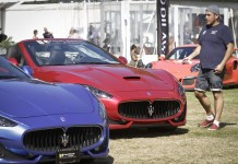 Resident looks at some super cars at the luxury and super car show in Vancouver, Canada, Sept. 11, 2015. The two-day event showcased over 180 luxurious and limited cars. (Xinhua/Liang sen)