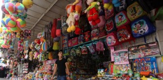 "A Palestinian vendor sells toys made in China at his store, in the West Bank city of Nablus, on Sept. 12, 2015. For many Palestinian business men, Chinese goods are good choices due to the cheap price. In Nablus, ""China"" is a common word to everyone, and made-in-China goods are everywhere in markets and sold for reasonable prices.(Xinhua/Nidal Eshtayeh)"