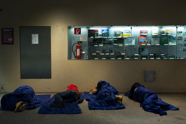 Refugees rest at a railway station in Salzburg, Austria, on Sept. 14. 2015. German Interior Minister Thomas de Maiziere on Sunday announced that Germany temporarily reinstates border control amid the ongoing refugee crisis. According to German newspaper