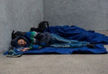 """Refugees rest at a railway station in Salzburg, Austria, on Sept. 14. 2015. German Interior Minister Thomas de Maiziere on Sunday announced that Germany temporarily reinstates border control amid the ongoing refugee crisis. According to German newspaper """"Passauer Neue Presse"""", the German government also stopped the trains to and from Austria. (Xinhua/Qian Yi)"""