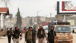 Militants walk in the Syrian city of Idlib on March 29, 2015. (Photo by AFP)