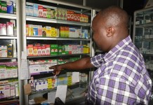 A shopkeeper displays available malaria drugs at a chemist in Nairobi, capital of Kenya, Oct. 15, 2015. Africa, a continent continuing to bear the brunt of the burden of malaria, has been one of the biggest beneficiaries of the discovery of artemisinin. According to the World Health Organization (WHO), in 2013, an estimated 163 million cases of malaria occurred in Africa, causing approximately 528,000 deaths.(Xinhua/Nyalwash)