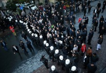 Supporters confront the police in front of the building of a media group in Istanbul, Turkey, on Oct. 28, 2015. Turkish police on Wednesday used tear gas and water cannon to storm the headquarters of the media group known for its opposition to the government. (Xinhua/Cihan)