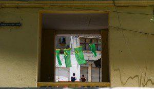Two men walk under the flags of Tanzania's ruling party Chama Cha Mapinduzi in Stone Town of Zanzibar, Tanzania, on Oct. 28, 2015. Tanzania's semi-autonomous archipelago Zanzibar on Wednesday has cancelled results of its just-held general elections, according to Zanzibar Electoral Commission. (Xinhua/Zhai Jianlan)