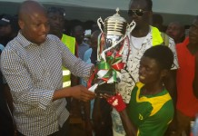 Mr Samuel Okudzeto Ablakwa, Member of Parliament for the area presenting the trophy to the team captain of Ablakwa FC.