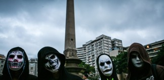 People attend a Zombie March, held during the Halloween celebration, at Plaza Altamira of Caracas, Venezuela, on Oct. 31, 2015. (Xinhua/Boris Vergara)