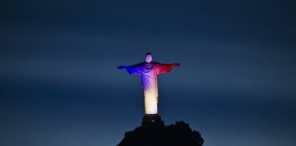 The Christ the Redeemer statue is illuminated with the colors of the French national flag to mourn for the victims of the terrorist attacks in Paris, in Rio de Janeiro, Brazil, Nov. 14, 2015. (Xinhua/AGENCIA ESTADO) (zjy) ***BRAZIL OUT***