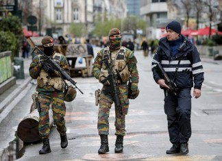 "Belgian soldiers and a policeman patrol in central Brussels, capital of Belgium, on Nov. 22, 2015. The terror threat level in the Brussels region was increased to ""maximum"" as authorities received information on the risk of an attack ""similar to Paris."" The terror threat currently facing Belgium is ""broader than Salah Abdeslam alone"", the country's interior minister Jan Jambon said in a TV interview late Saturday. (Xinhua/Zhou Lei)"