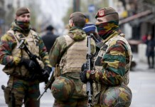 "Belgian soldiers patrol in central Brussels, capital of Belgium, on Nov. 22, 2015. The terror threat level in the Brussels region was increased to ""maximum"" as authorities received information on the risk of an attack ""similar to Paris."" The terror threat currently facing Belgium is ""broader than Salah Abdeslam alone"", the country's interior minister Jan Jambon said in a TV interview late Saturday. (Xinhua/Zhou Lei)"