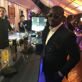 Don Jazzy stride in a dapper suit at the official welcome cocktail party of