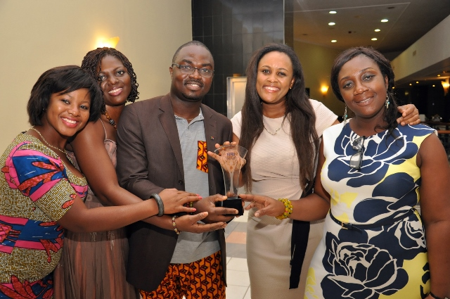 MTN CORPORATE COMMS TEAM DISPLAYING THE AWARD- L-R SHEILA SORINYE, AFUA ...