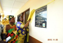 Mrs. Cynthia Lumor, Executive Director of MTN Foundation unveiling plaque to commission the school block. Looking on is the Chief of Asikasu a