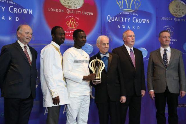 Managing Director of ASN-FSL, Mr. Johannes Okutu, displaying the International Quality Crown