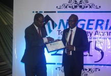 Bashir Kabir (right) Country Manager of West Blue, Nigeria taking the award