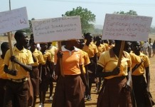 School children bearing placards at this year's World Toilet Day event in the Upper East Regon.