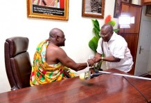 Osu Mantse Nii Okwei Kinka Dowuona in a hand shake with NDPC boss Dr Nii Moi Thompson