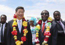Chinese President Xi Jinping and President Robert Mugabe at the Harare International Airport