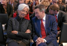 Christine Lagarde (L), managing director of International Monetary Fund (IMF), talks with Peter Maurer, president of International Committee of the Red Cross (ICRC), at an annual meeting of the World Economic Forum (WEF) in Davos, Switzerland, Jan. 20, 2016. The leaders from various key sectors highlighted the 4th industrial revolution will be driven by renewable energy at the 46th WEF annual meeting, which kicked off on Wednesday in Davos-Klosters, Switzerland. (Xinhua/WORLD ECONOMIC FORUM/Remy Steinegger)