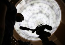 A cameraman works at the 26th AU summit in Addis Ababa, capital of Ethiopia, on Jan. 30, 2016. The 26th ordinary session of the African Union (AU) heads of states and governments kicks off on Saturday at the AU Headquarters in Addis Ababa. (Xinhua/Pan Siwei)